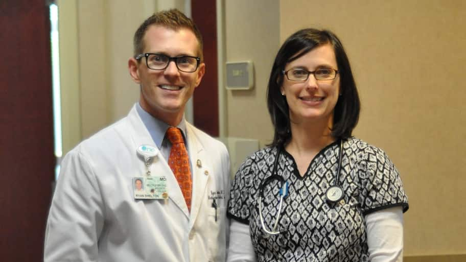 doctor and nurse posing for photo