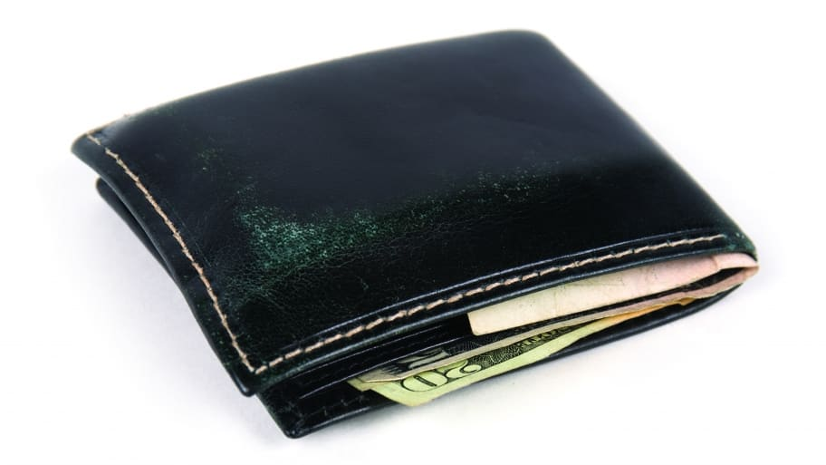 wallet with money sticking out (Photo by Eldon Lindsay)