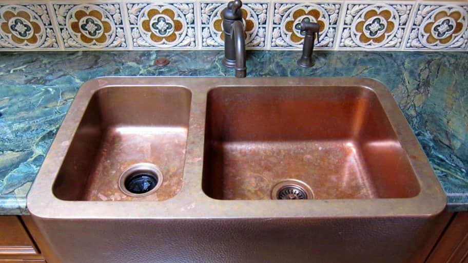 pros and cons of copper kitchen sinks angie s list rh angieslist com farmhouse kitchen sink copper kitchen sink copper soap dispenser