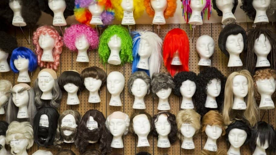 display of wigs for costumes