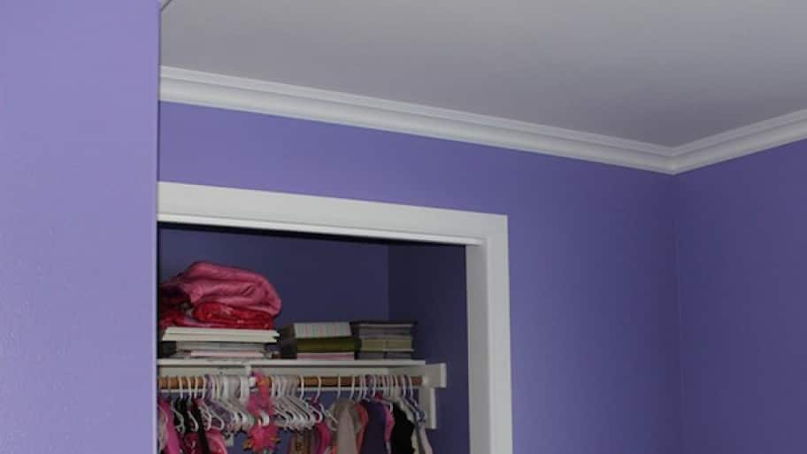 crown molding in a purple and white bedroom