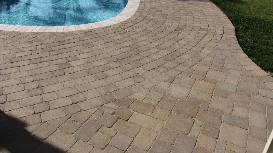 custom pavers pool drainage