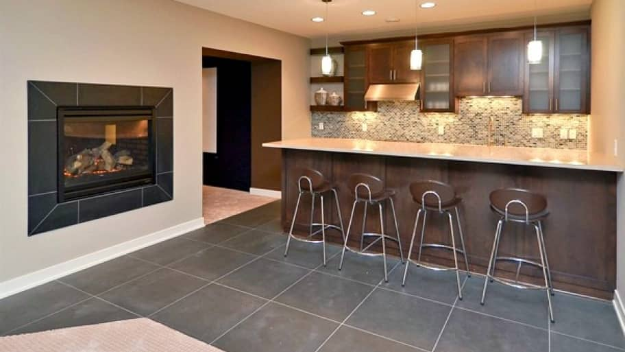 Adding additional kitchen and entertaining spaces are popular options when finishing your basement. (Photo by Angie's List member Rajinder S.)