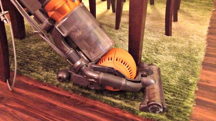high-powered vacuum cleaner on area rug