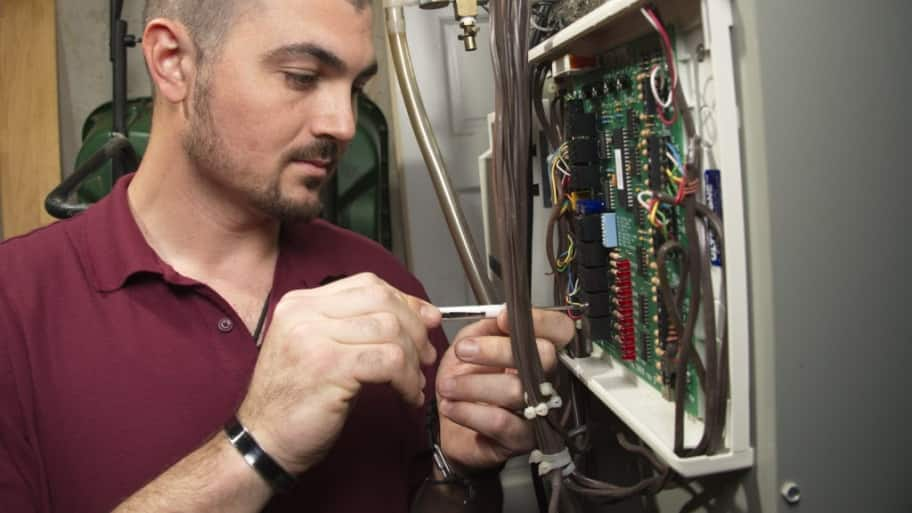 technician installing dehumidifier