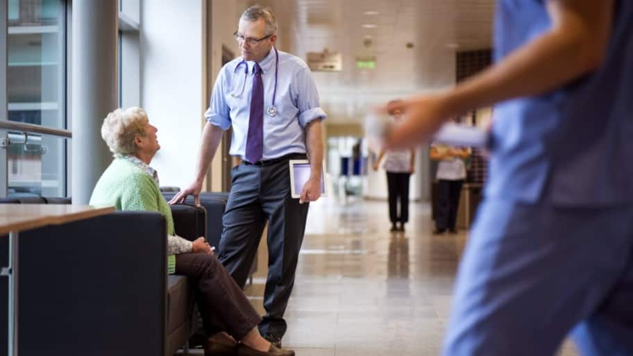 A doctor meets with a patient