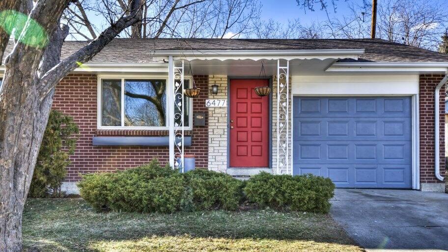 home exterior with door, window