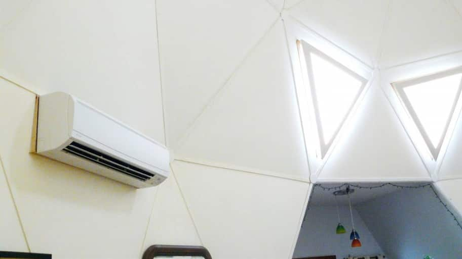 Ductless A/C system vent mounted on wall