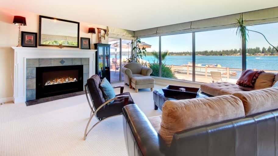 Lovely Electric Fireplace In Living Room With Beach View