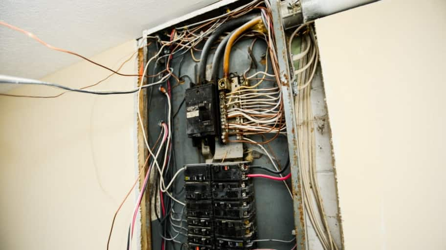 breaker box with exposed wires