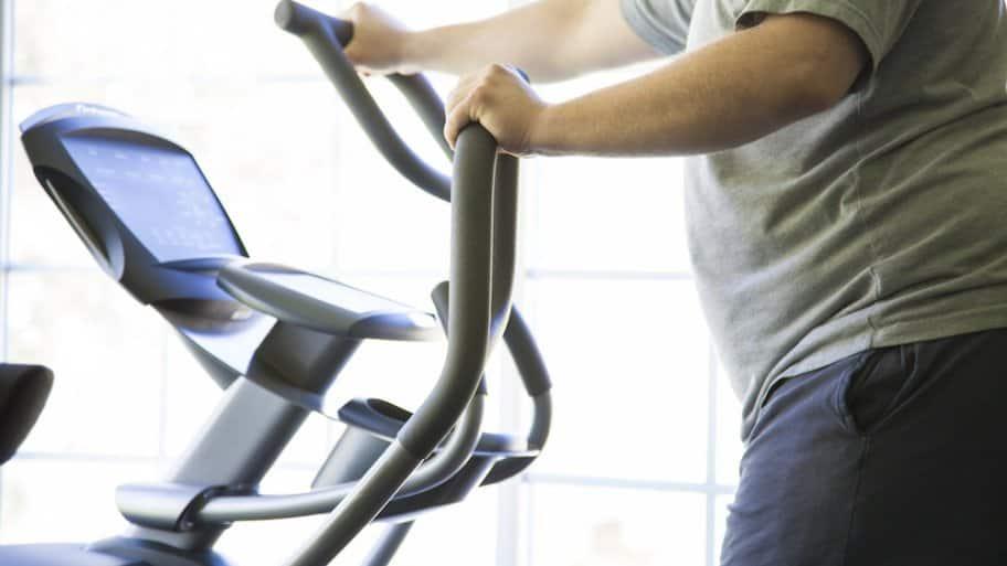 Man on exercise equipment