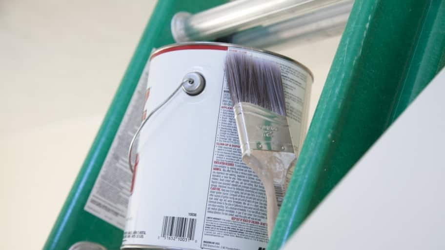 Can of paint on a ladder
