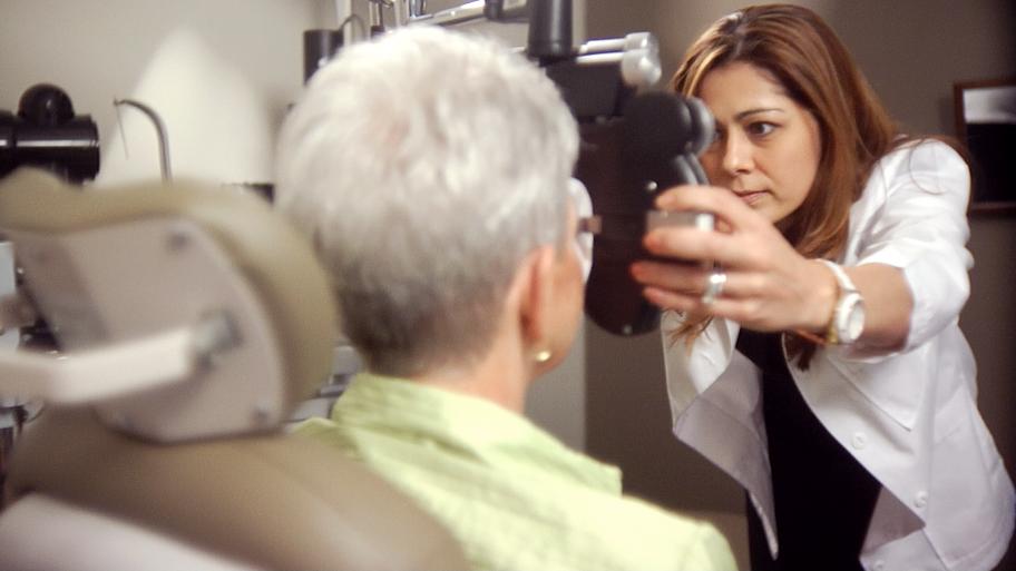female eye doctor conducting exam