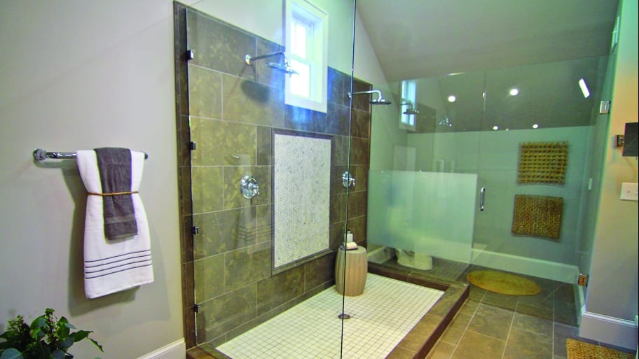 bathroom with large enclosed frameless shower