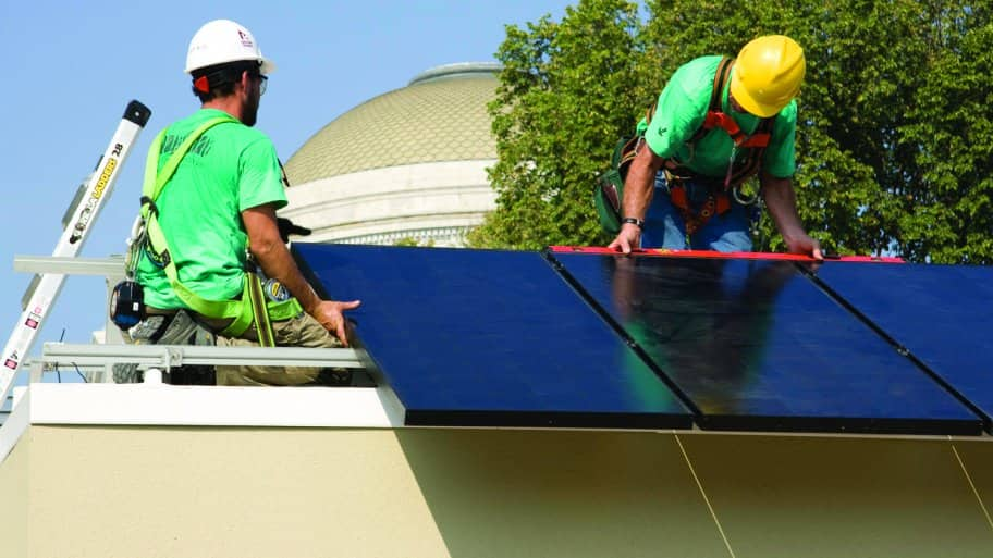 two men on roof installing solar panels