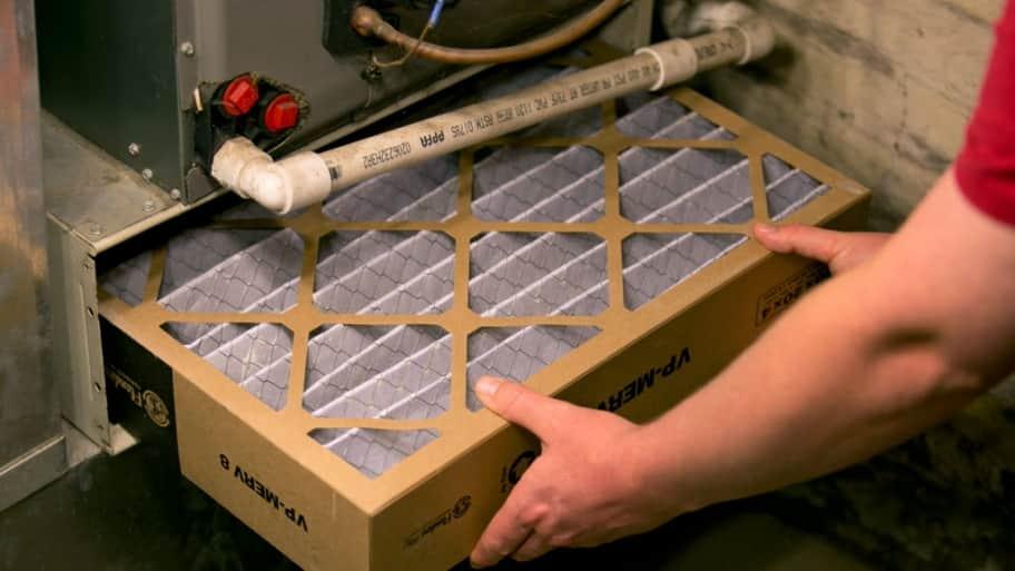 Worker Installing Hvac Filter