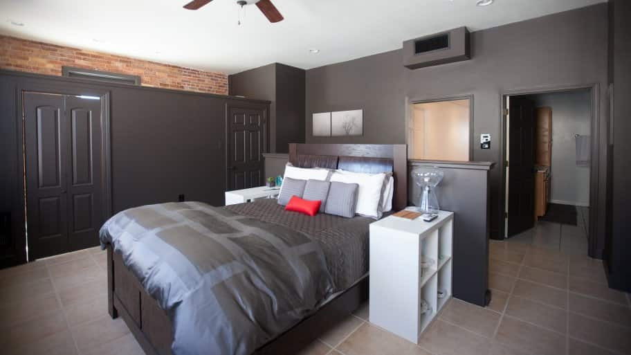 bed in center of room