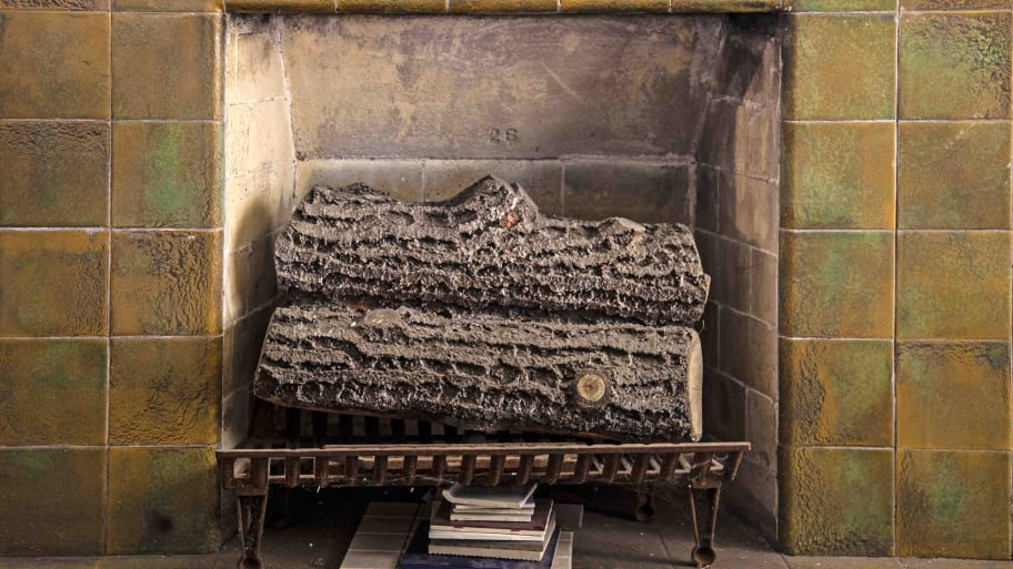 Delightful Cost To Remove A Fireplace Part - 4: Little Fireplace With Logs And Tile Surround