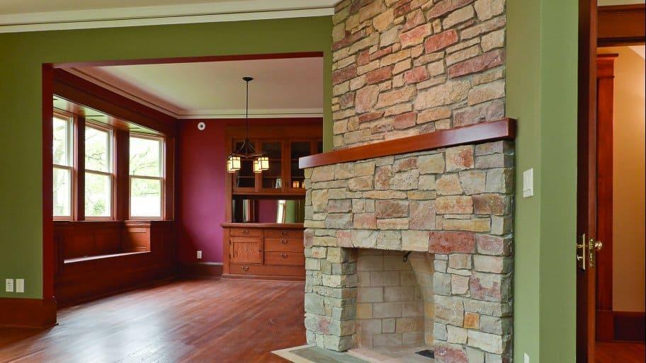 Empty Woodburning Fireplace Stone Surround Wood Floor