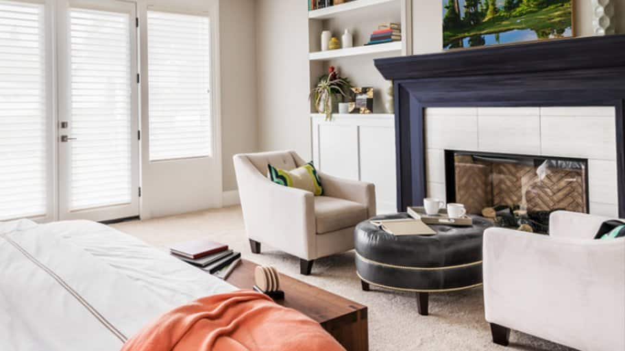 Black fireplace mantel with white surround