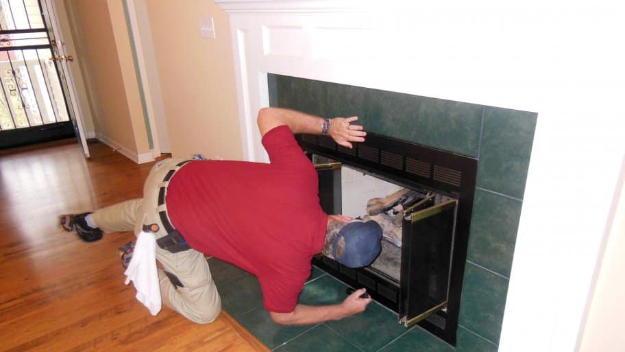 home inspector doing a fireplace inspection
