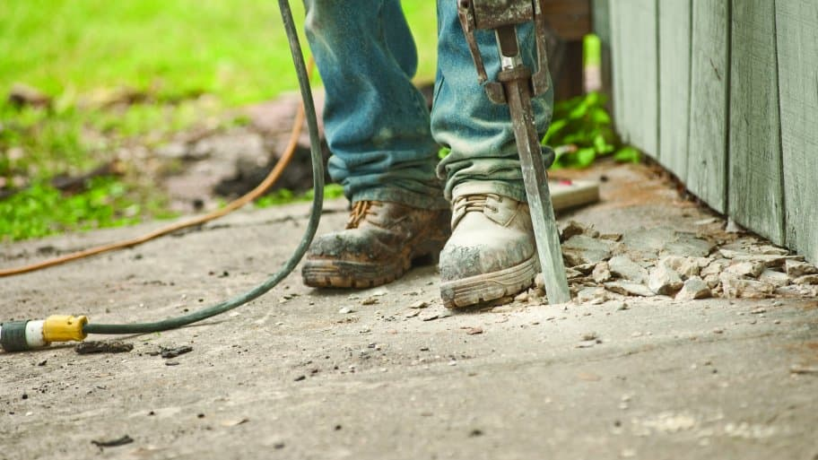 foundation repair contractor jackhammering concrete