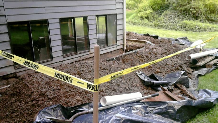 drainage foundation repair work on house