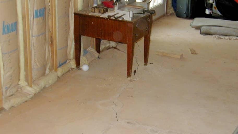 Unfinished basement with cracks