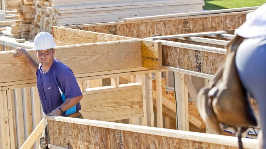 construction worker frames new house (Photo by Brandon Smith)