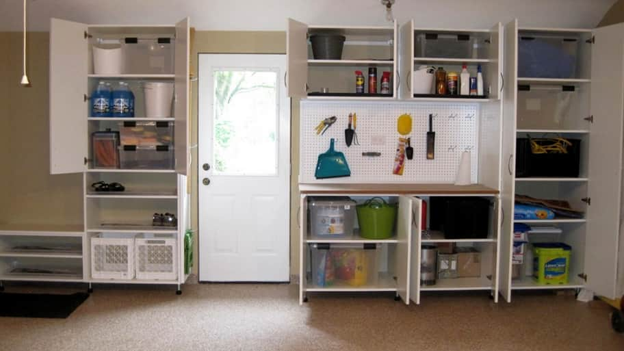A garage with cabinets and wall storage