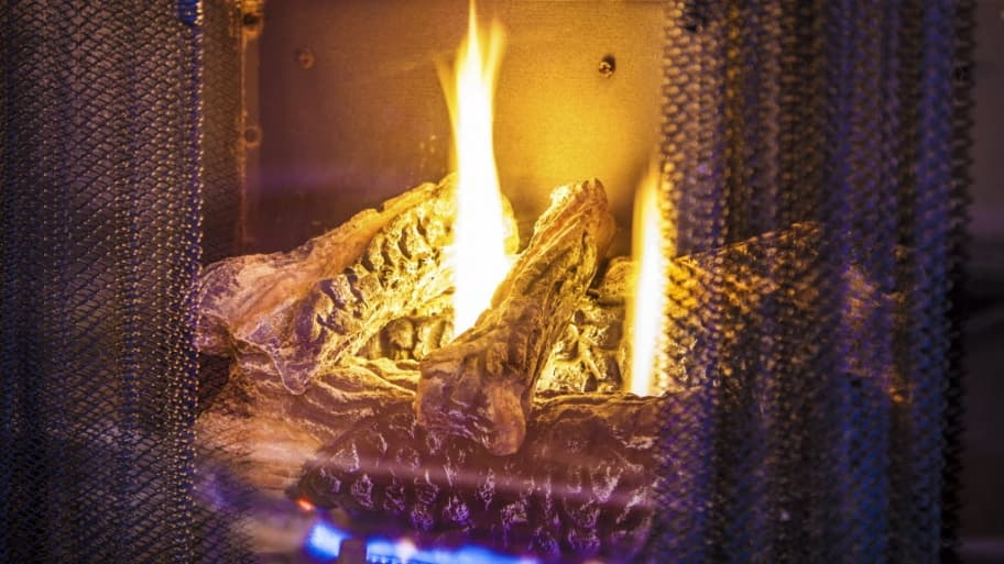 fireplace lighting. gas fireplace with fire burning lighting