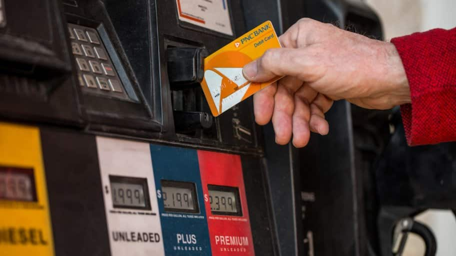 Hand with credit card at gas pump