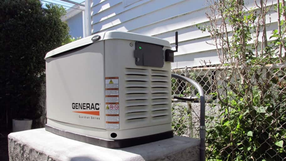 generac backup electric power generator outside home