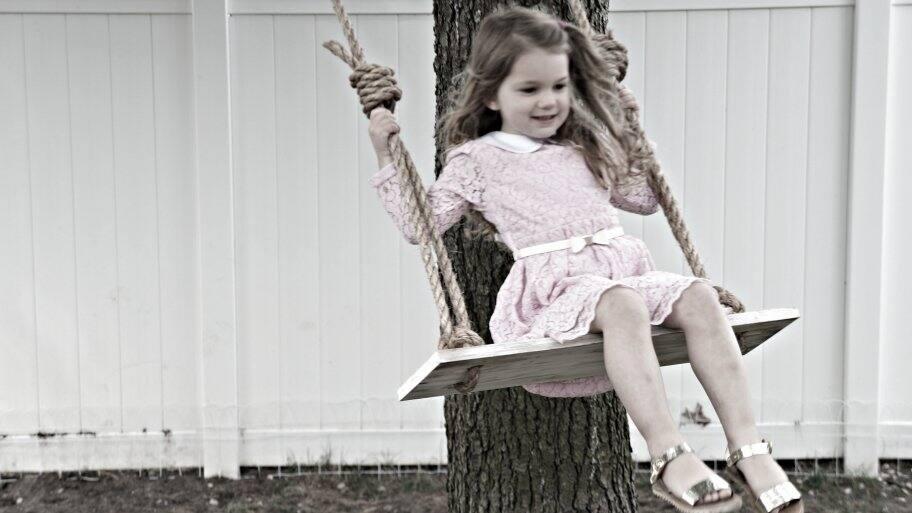 girl on rope tree swing