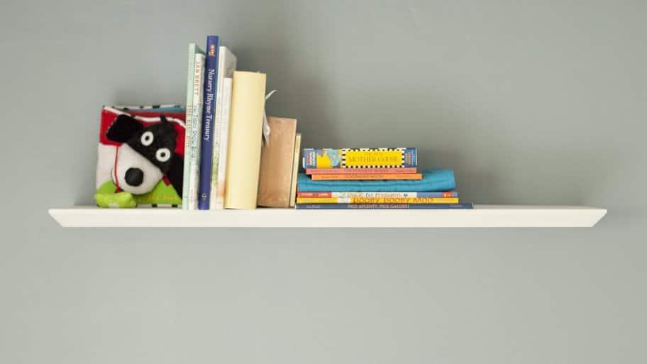Shelf on gray wall
