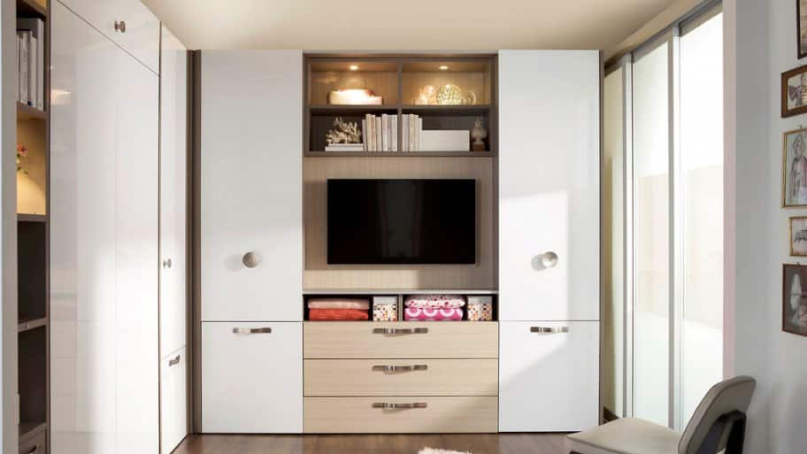 open white cabinet with flat screen TV, side doors and bottom drawers