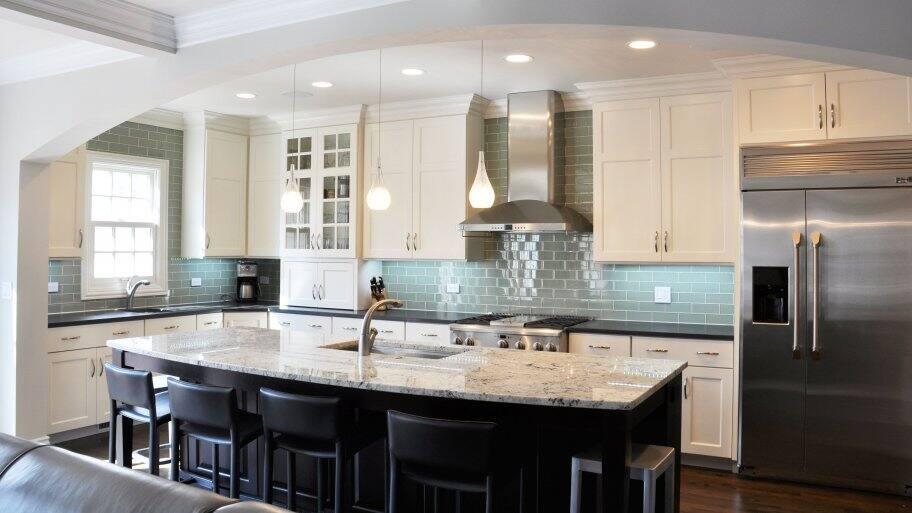 black kitchen island in white kitchen