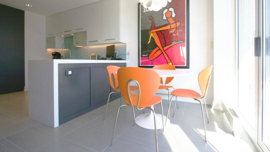 kitchen peninsula with dark gray cabinets