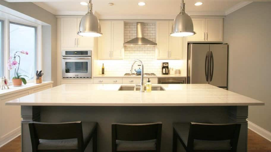 White Kitchen With Dark Gray Island Bar With Seating