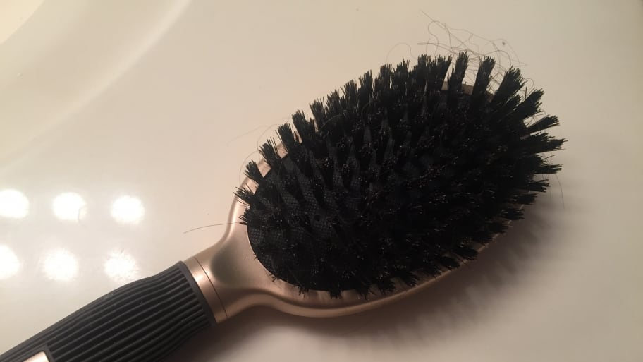 hairbrush with hair in it
