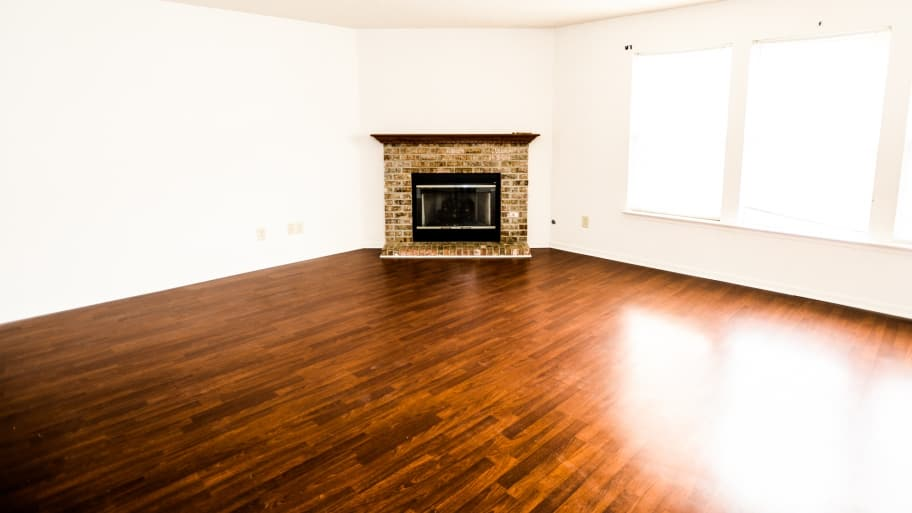 hardwood flooring and a fireplace - The Costs Vs. Benefits Of Hardwood Flooring Repair Angie's List