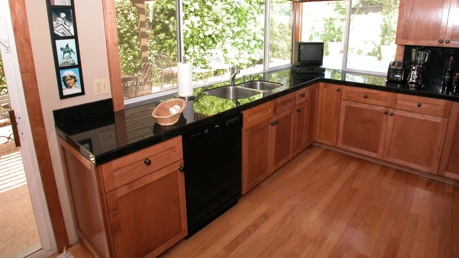 cherry hardwood floors and cabinets in kitchen. beautiful ideas. Home Design Ideas