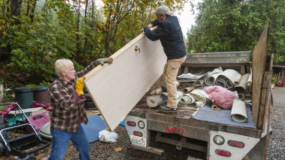 Professional haulers load a truck