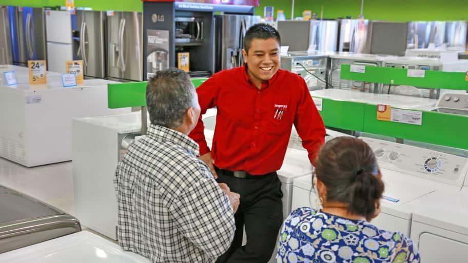 customers shopping for a washer dryer at hhgregg