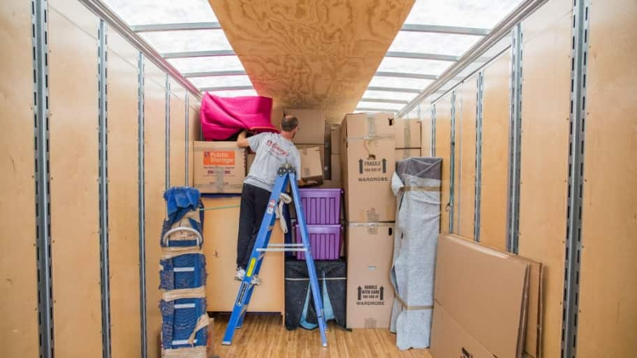 Moving crews loading a moving truck