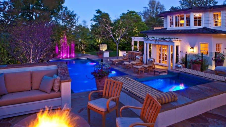 illuminated pool and firepit and water feature