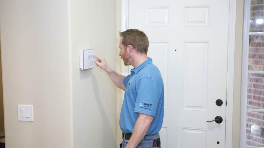 man working on alarm system