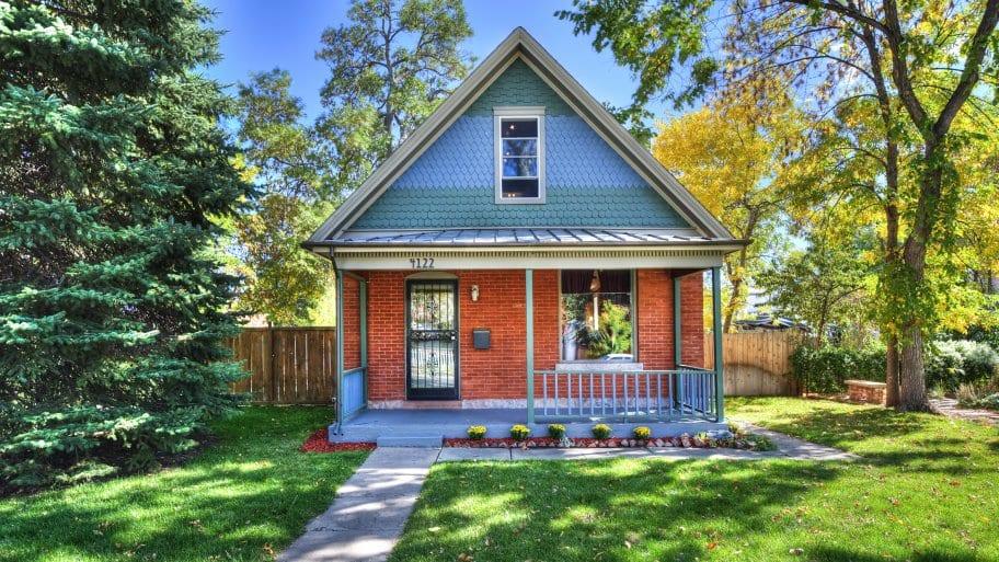 cottage home with brick, shake siding
