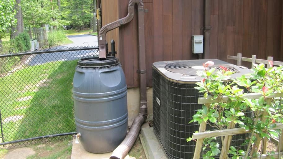 rain barrel attached to downspout