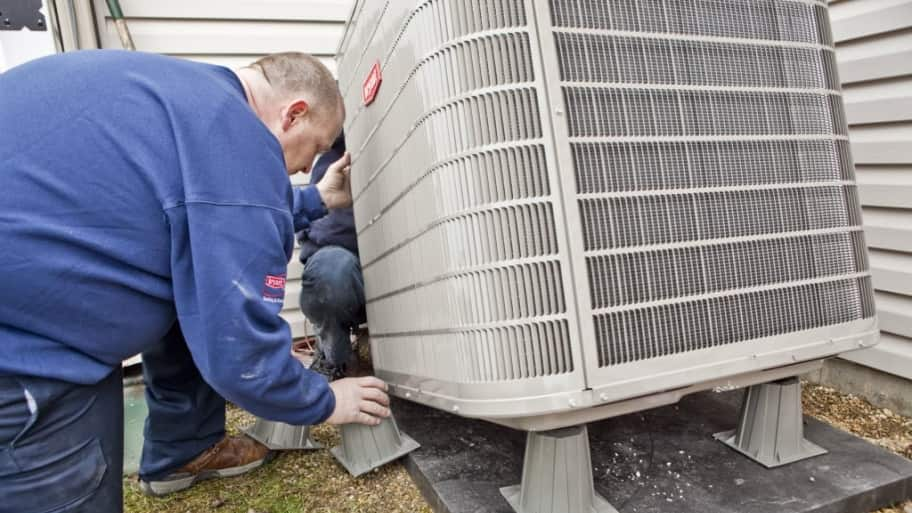 technician installing HVAC unit